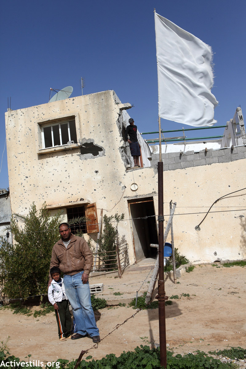 nasser abu sa'eed and his son at their house in juhor al deek which they finally left after it was shelled yet again in 2011