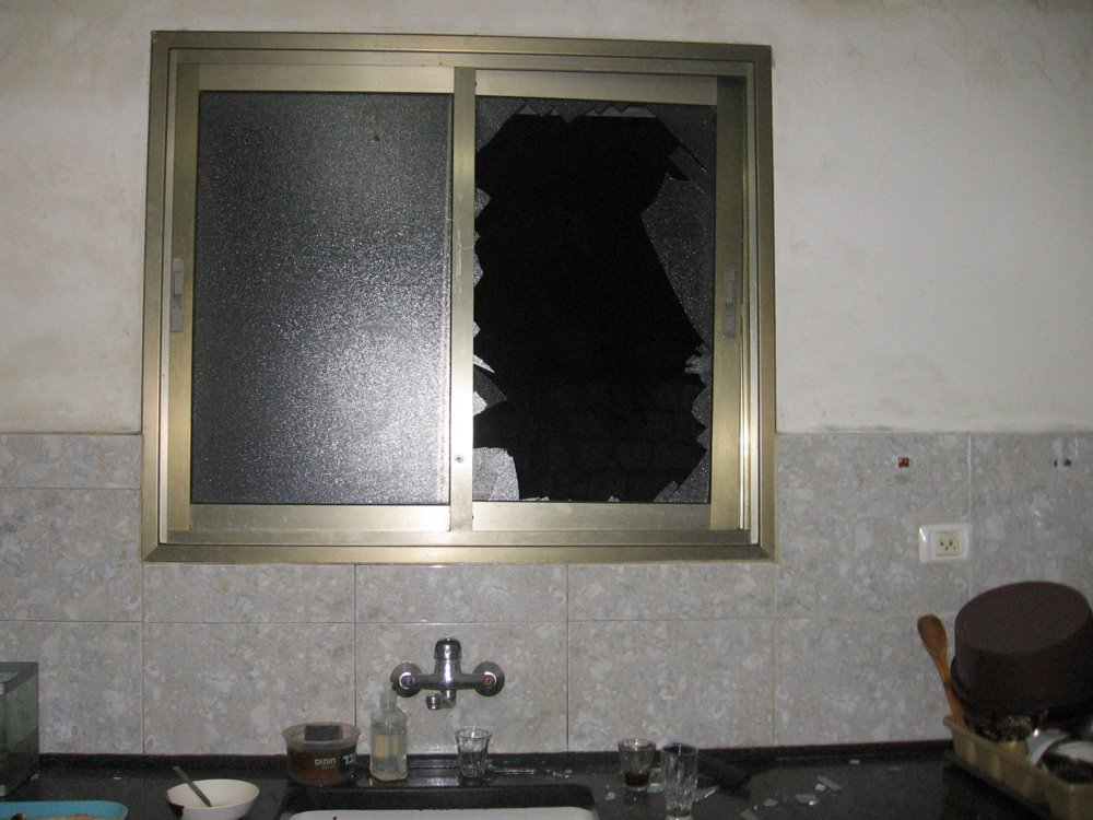 window broken in the Awad's home by military raid