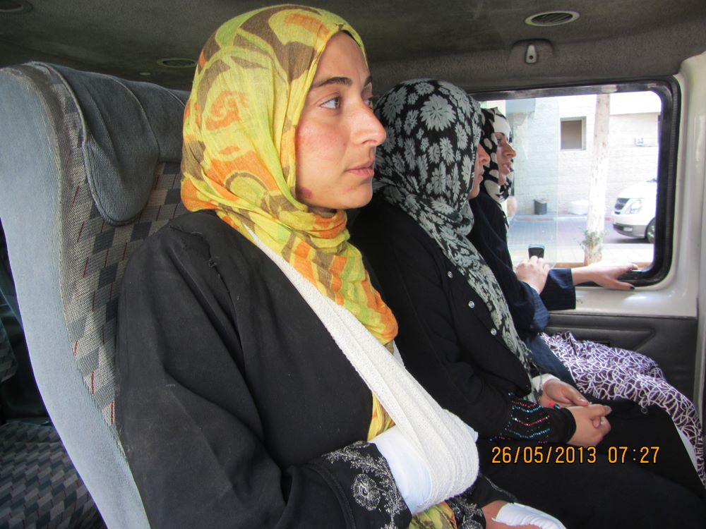 Abed Al Rahem Awad's sister whose hand was broken after being attacked by Israeli soldiers during a night raid