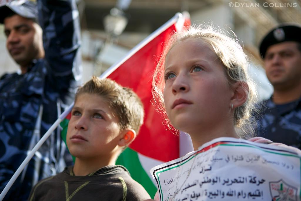 nariman's daughter ahed (12) and shaker's son ahmad (12) at the funeral procession in ramallah; photo: dylan collins